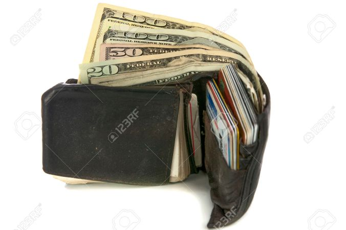 23663455-worn-out-wallet-with-cash-and-credit-cards-on-white-stock-photo